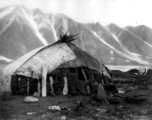 Eskimo woman. winter hut. Plover Bay Siberia E Curtis1899