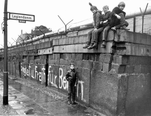 Children play on the Berlin Wall