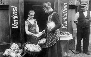 woman exchanges vegetables baskets money hyperinflation1923